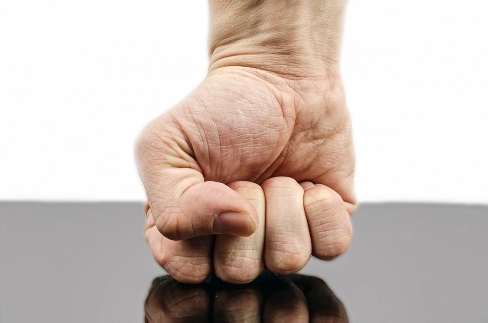 a fist striking a table