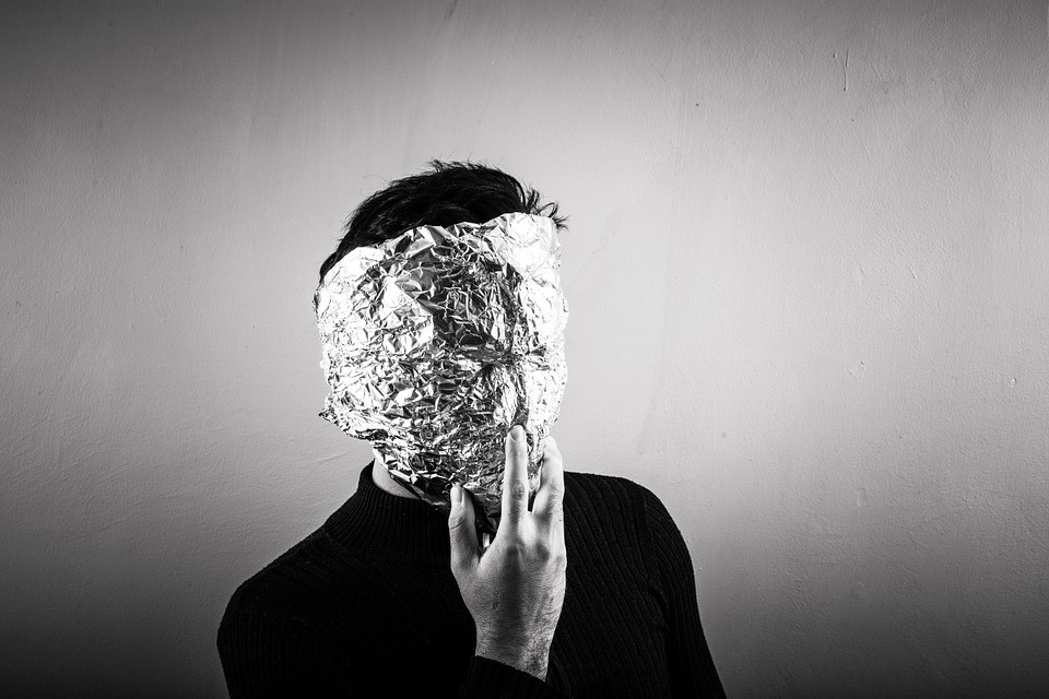 person wearing a tin foil mask