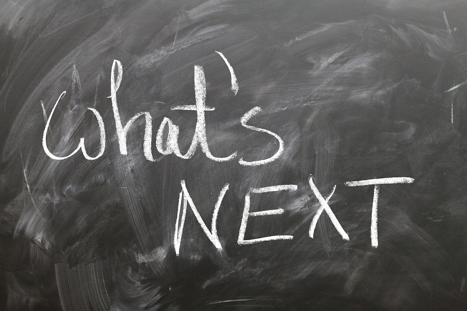 """a chalkboard with """"what's next?"""" written on it"""