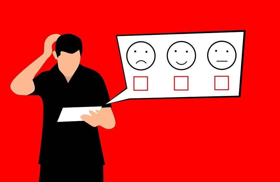 a cartoon of a person choosing between a happy, neutral, and sad face