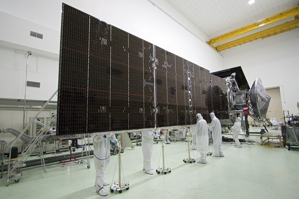 scientists working on a solar cell array in clean suits