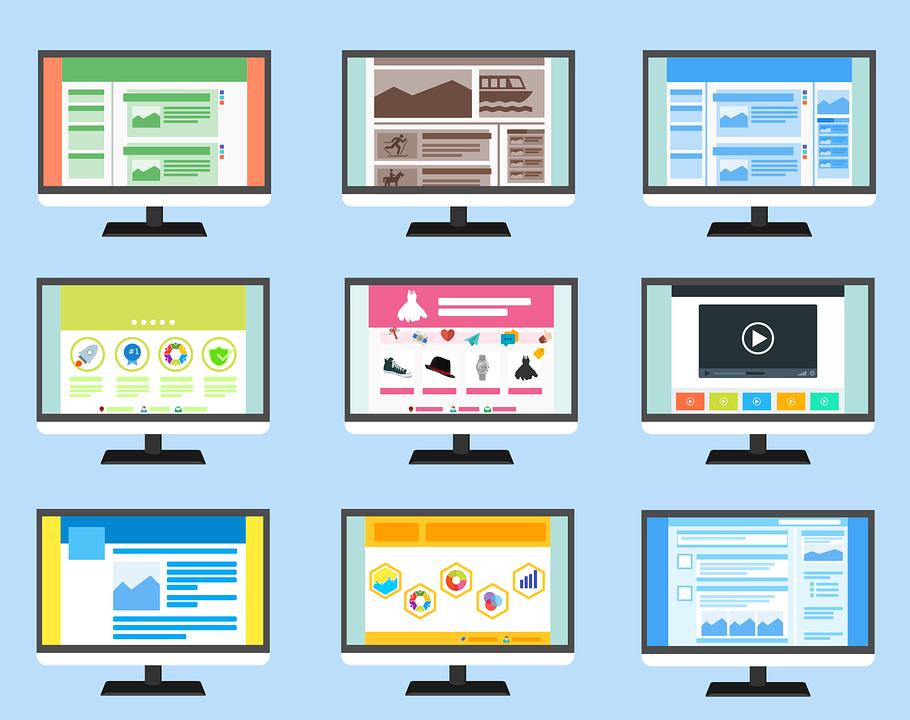 nine computer monitors with cartoon graphics displayed on them
