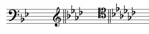 A two-flat key signature after a bass clef, a four-flat key signature after a treble clef, and a six-flat key signature after a tenor clef.