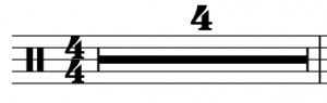 """A filled-in rectangle with the number """"4"""" appears, indicated a rest that will last for four measures"""