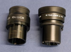 Figure 2.4.15. Eyepieces or oculars removed from two different brands of polarizing light microscope. The magnification (10x) is marked on each ocular.