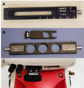 Figure 2.4.17. Examples of accessory plates. a) A quartz wedge plate. b) A 530 nm plate (top) and a combination 530 nm and 1/4 wavelength plate (bottom). c) Some microscopes include storage of accessory plates in the microscope itself, while others are stored in separate boxes.