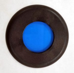Figure 2.4.6. A blue filter from a polarizing light microscope. This filter sits on top of the illuminator.