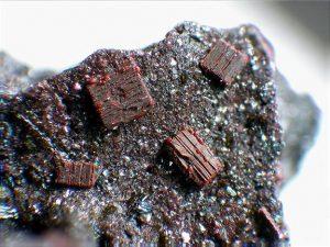 Figure 2.6.6 C. Fayalite (Fe-rich olivine) crystals from Eifel, Germany.