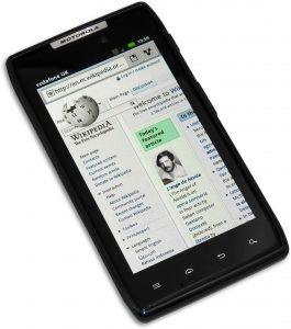 A cell phone, the Droid RAZR, sits on a white background, with the screen displaying a webpage.