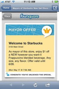 """A screenshot from a mobile device, showing a Starbucks and Foursquare promotion. The top of the screen says """"Foursquare,"""" and the promotion header is """"Mayor Offer."""" The promotion reads: """"Welcome to Starbucks, 3193 Main Street. As mayor of this store, enjoy $1 off a NEW however-you-want-it-Frappuccino blended beverage. Offer valid until 6/28. Monday, May 17 @ 7:56 AM."""" Under the promotion is """"Congrats! You've unlocked this special."""""""