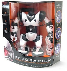 """A photograph of a Robosapien, similar to the one pictured in figure 14.1, in its original packaging on a white background. The front of the package says """"Robosapien; A Fusion of Technology and Personality."""""""